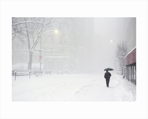 Pedestrian Walking Along Snowy Street by Corbis