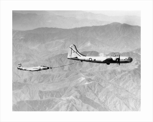 Midair Refueling of an American Navy Fighter Jet over Japan by Corbis