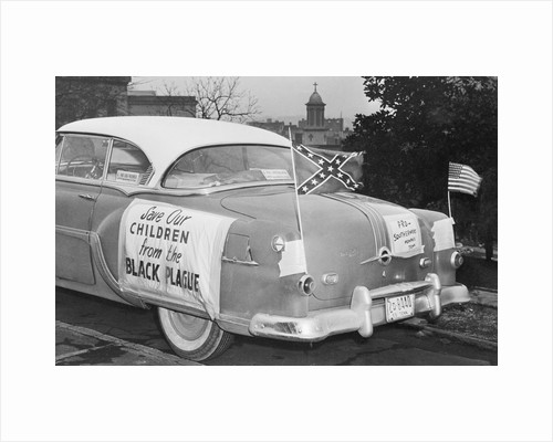 Automobile Decorated with Signs and American Flags by Corbis
