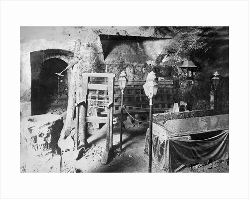 View of Torture Equipment in Cave Like Setting by Corbis