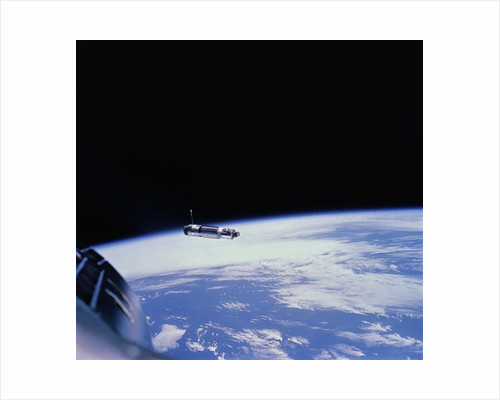 Gemini 8 Hovering Above Earth by Corbis