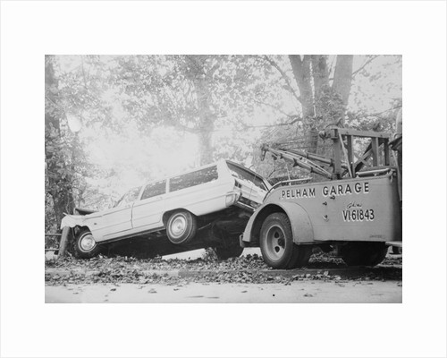 Tow Truck Towing Station Wagon by Corbis