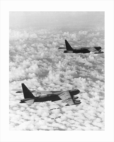 Military Airplane Dropping Bombs in Vietnam by Corbis