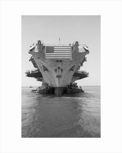 Tugboats Pushing the Aircraft Carrier John F. Kennedy by Corbis