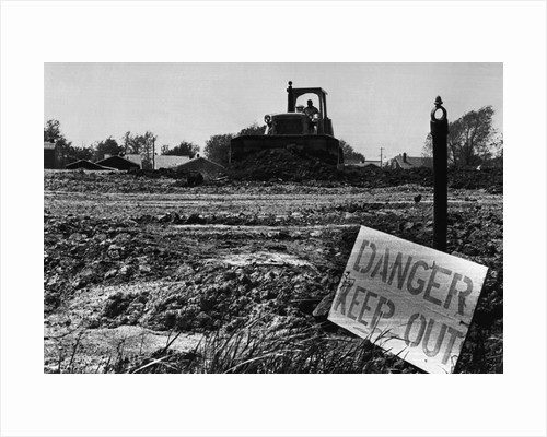 Danger Sign in Love Canal Lot by Corbis