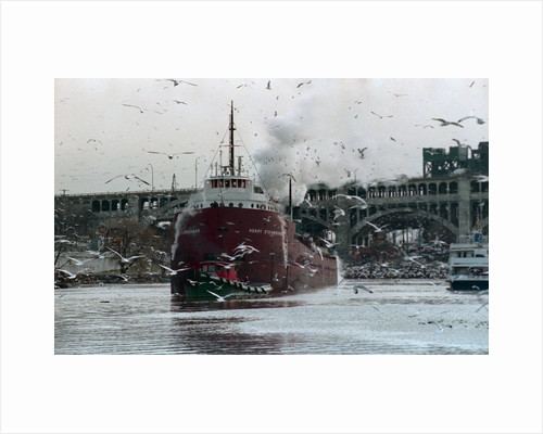 Tugboat Pulling Ore Carrier by Corbis