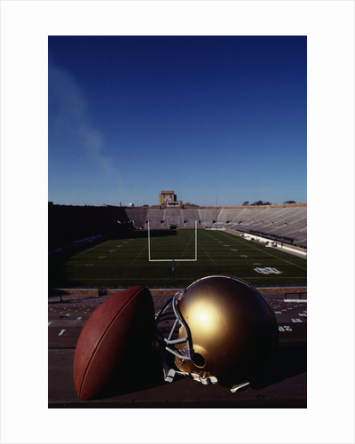 Notre Dame Football Helmet and Football at Notre Dame Stadium by Corbis