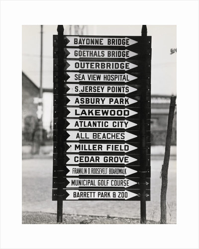 Signboard with Many Signs by Corbis