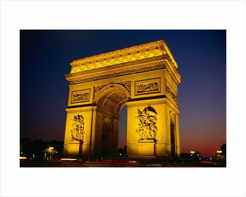 Arc de Triomphe de l'Etoile Illuminated at Night by Corbis