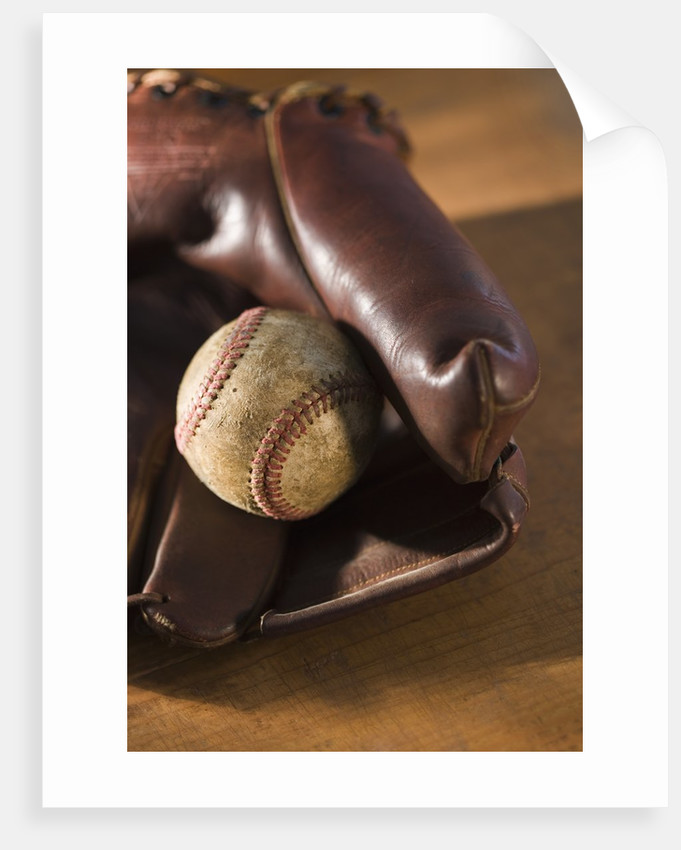 Baseball and Old Mitt by Corbis