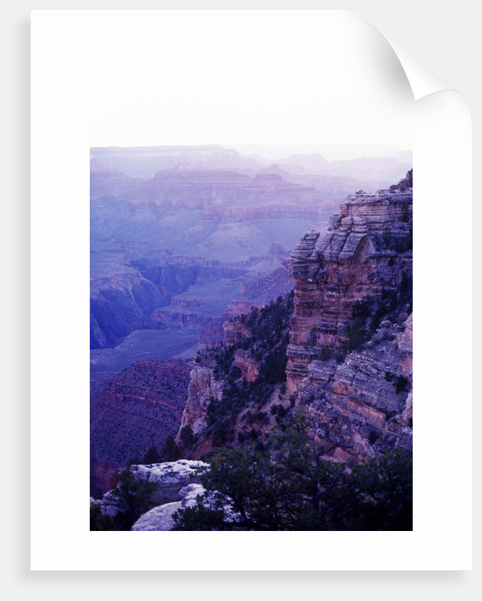 Sunset paints the Grand Canyon purple and mauve by Corbis