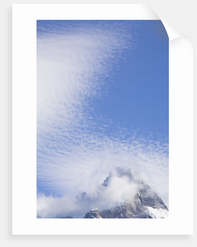 Cirrocumulus Clouds Above Rocky Crags by Corbis