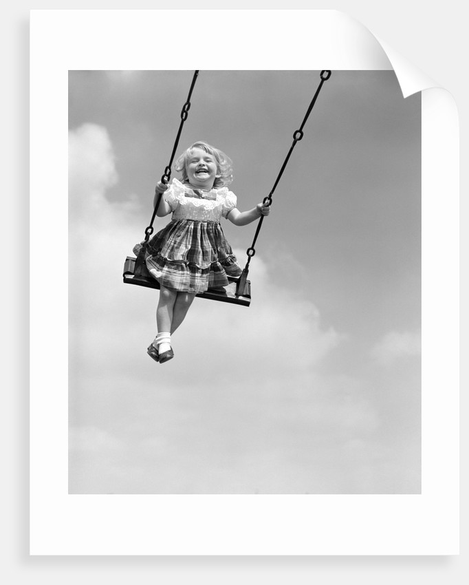 1950s Laughing Little Girl Swinging High On Outdoor Swing