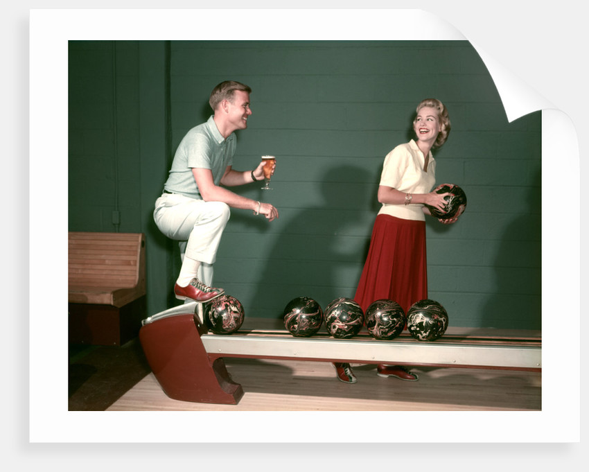1950s Couple In Bowling Alley Woman Holding Ball Man With Glass Of Beer I by Corbis
