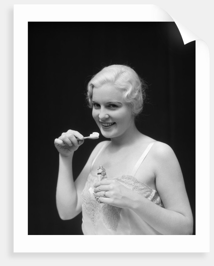 1930s Woman Holding Tooth Paste And Tooth Brush Btushing Teeeth by Corbis