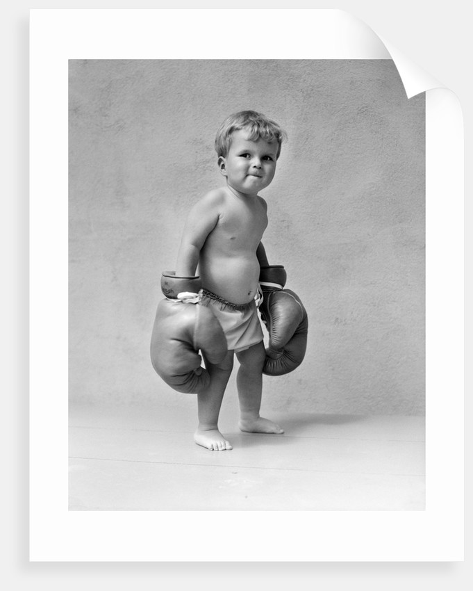 1930s Baby Boy Toddler Wearing Oversize Boxing Gloves by Corbis
