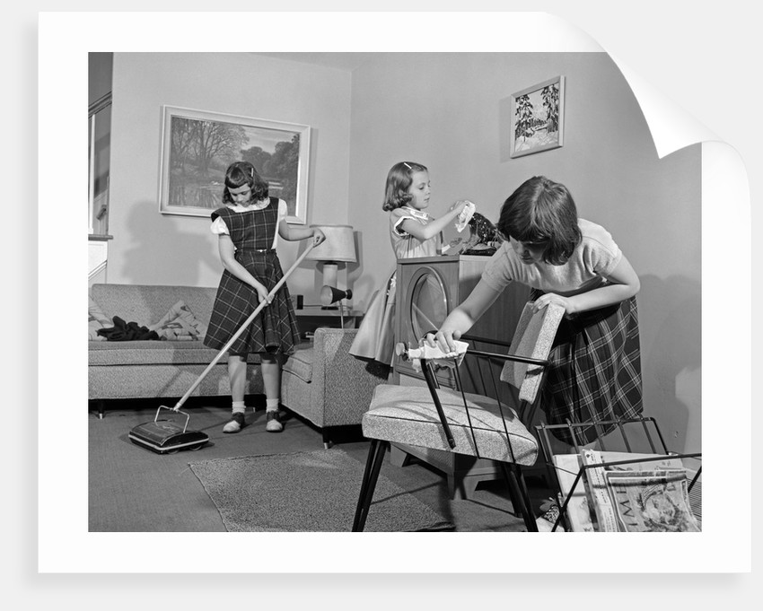 1950s three pre teen young girls cleaning living room dusting vacuuming by corbis