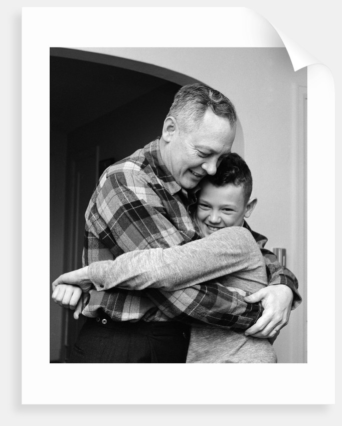 1950s 1960s Father And Son Hugging Indoor by Corbis
