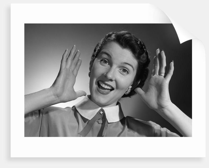 1950s Happy Woman Holding Hands Up Beside Her Head by Corbis