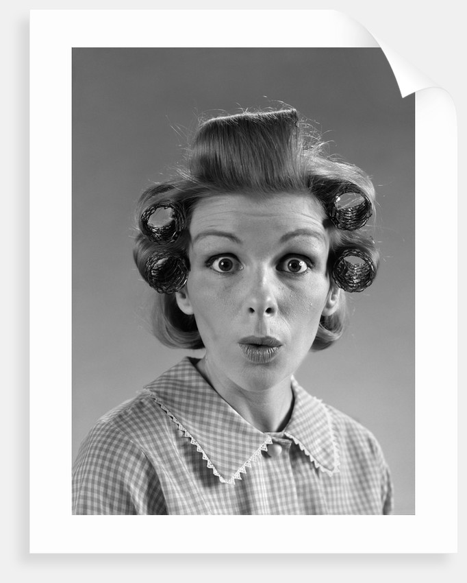 1960s portrait woman with hair in rollers eyes wide with suprise by corbis