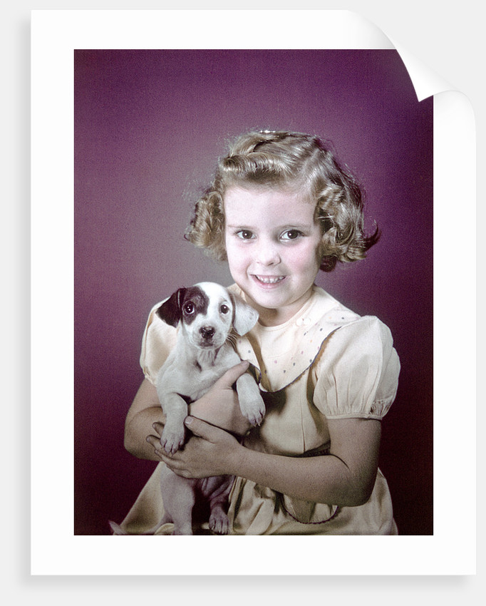 1940s 1950s Girl Holding Spotted Puppy by Corbis