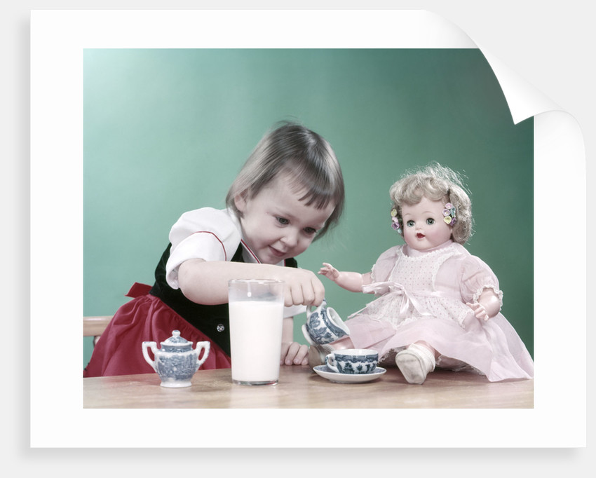 1950s Little Girl And Baby Doll Having Tea Party by Corbis
