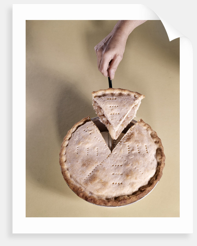 1970s Hand Serving Wedge Slice Of Apple Pie by Corbis