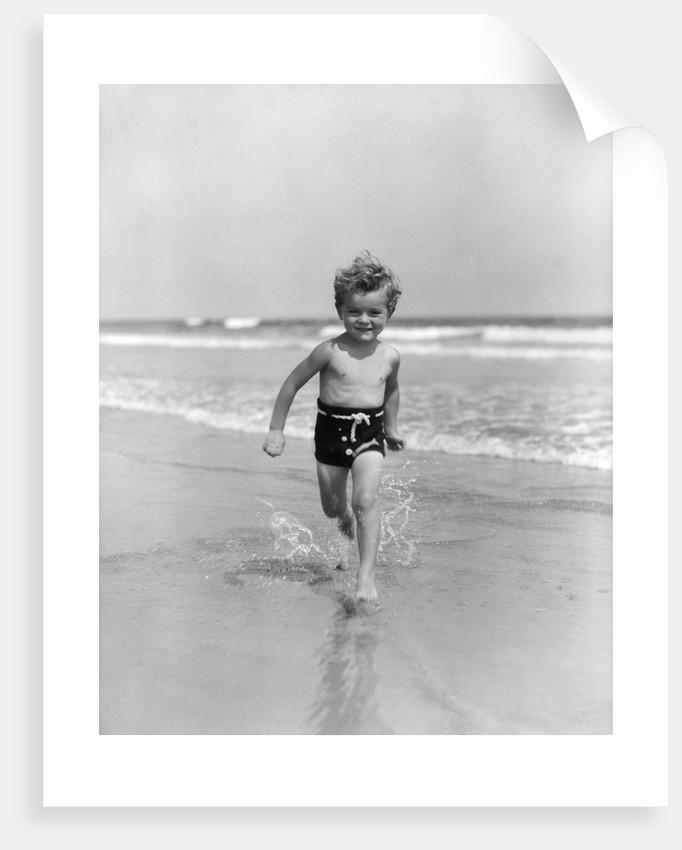 1930s Little Toddler Running In Surf by Corbis