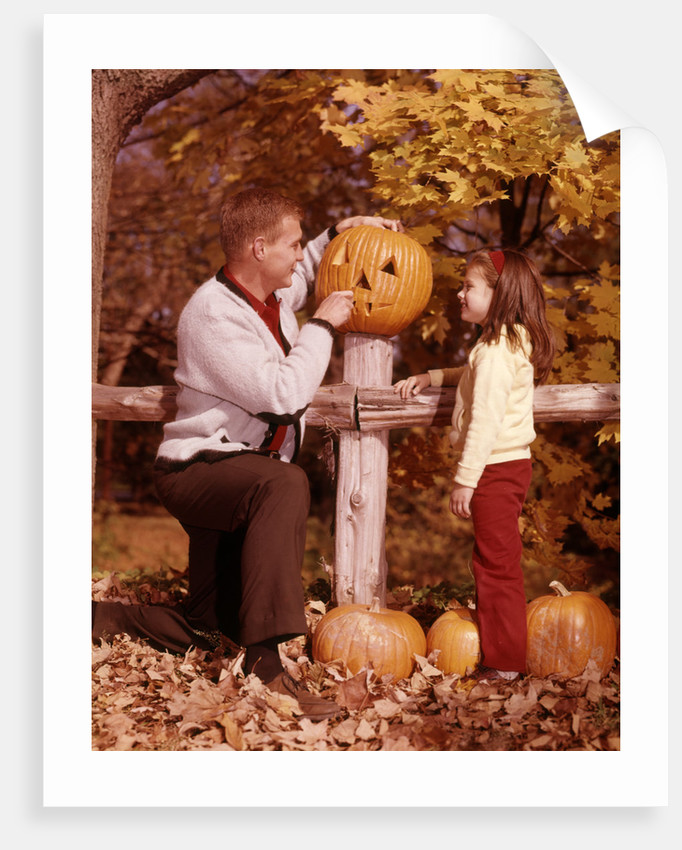 1960s Man Father And Girl Daughter Carving Halloween Jack-O-Lantern Pumpkin by Corbis