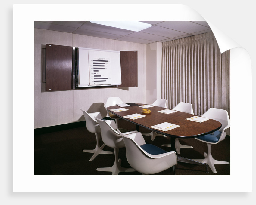 1960s Office Conference Room With Table Chairs Writing Pads Ashtray And Wall Chart by Corbis