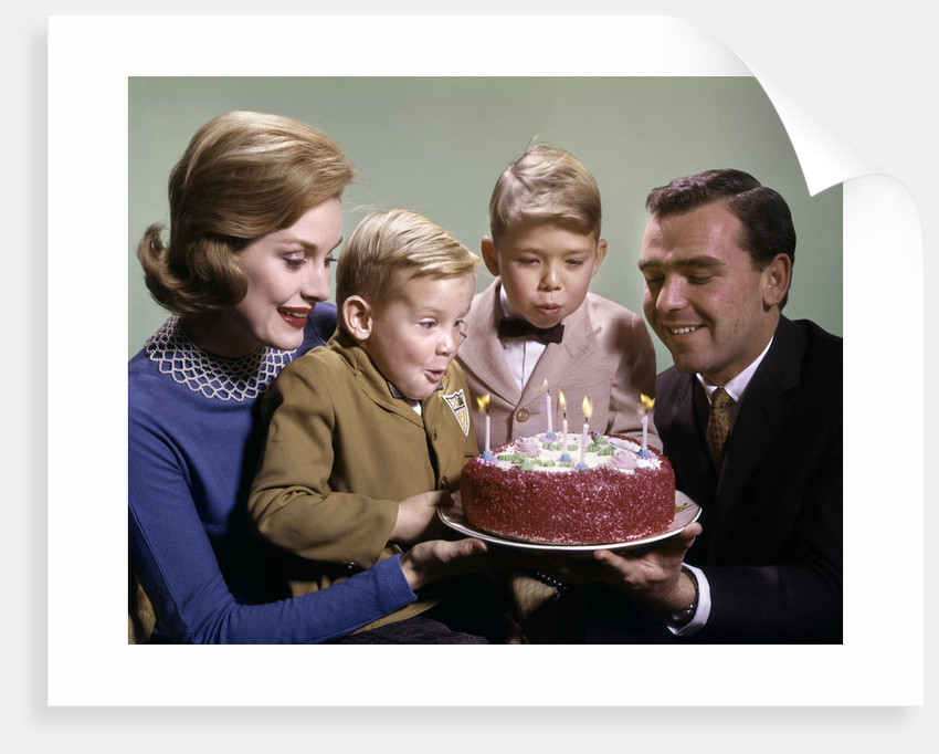 1960s Mother And Father Holding Birthday Cake Sons Blowing Out Candles By Corbis