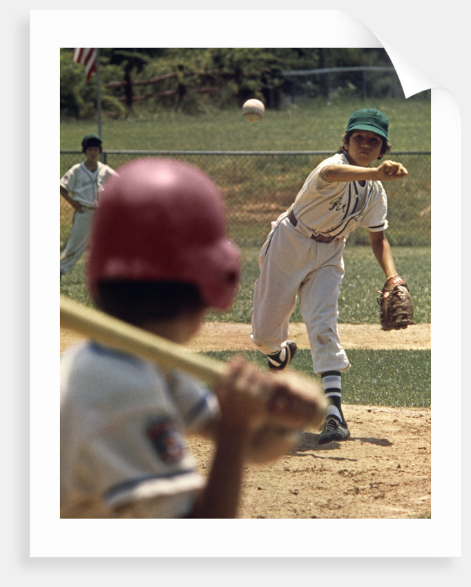 1970s Little League Baseball Game Boy Pitcher Throwing Ball To Batter by Corbis