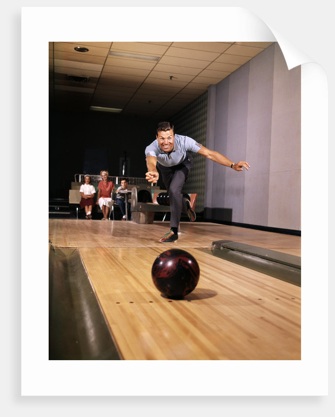 1960s Man In Good Form Releasing Bowling Ball Down Lane Wife Woman 2 Kids Behind Him by Corbis