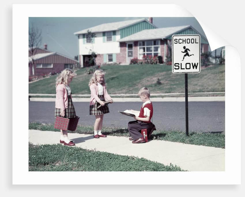 1950s Twin Girls and Boy On Sidewalk By School by Corbis