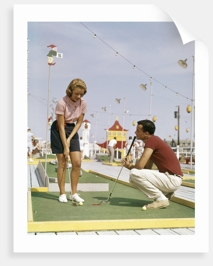 1950s 1960s Young Couple Man Woman Play Miniature Golf Summer Amusement by Corbis