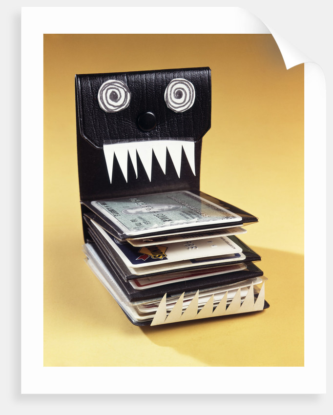 1960s Symbolic Monster Wallet With Wild Eyes And Sharp Teeth Filled With Credit Cards by Corbis
