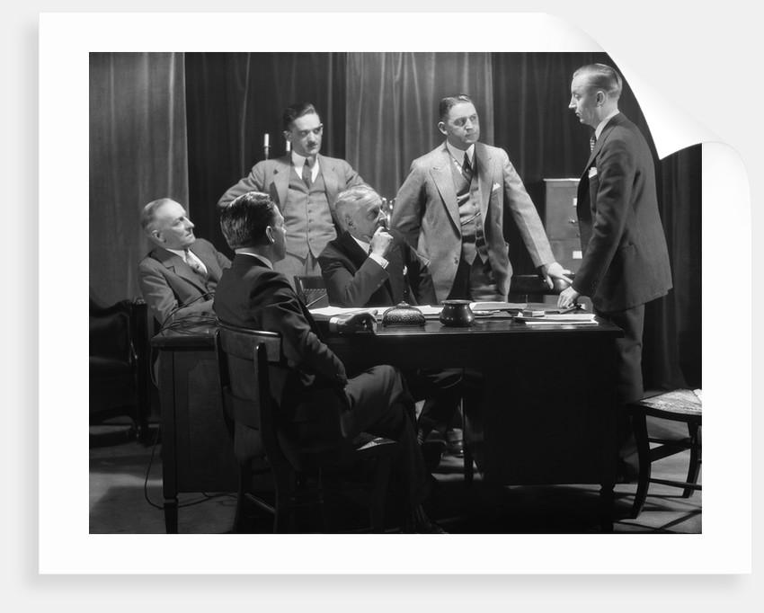 1930s Five Older Businessmen Meeting Around A Desk Listening To A Sixth Younger Man Speak by Corbis