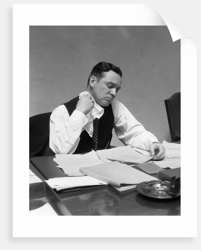 1930s Man At Desk In Office Wiping Neck With Handkerchief by Corbis