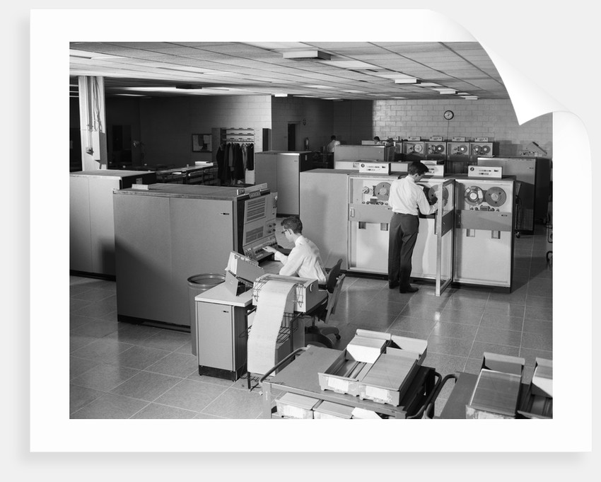 1960s two men technicians working in ibm 360 mainframe computer room by corbis