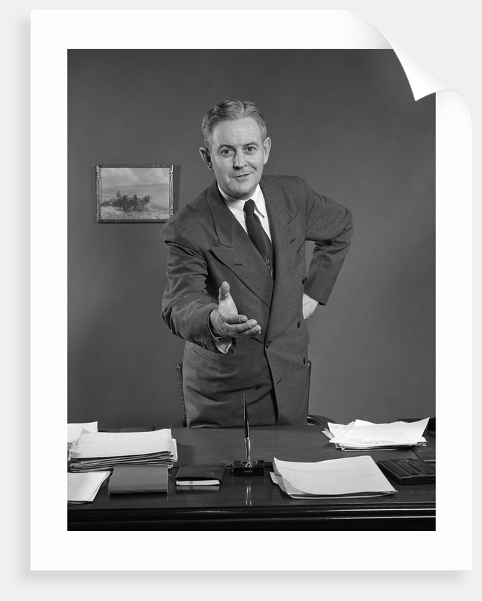 1950s Man Businessman Salesman Reaching Across Desk To Shake Hands by Corbis