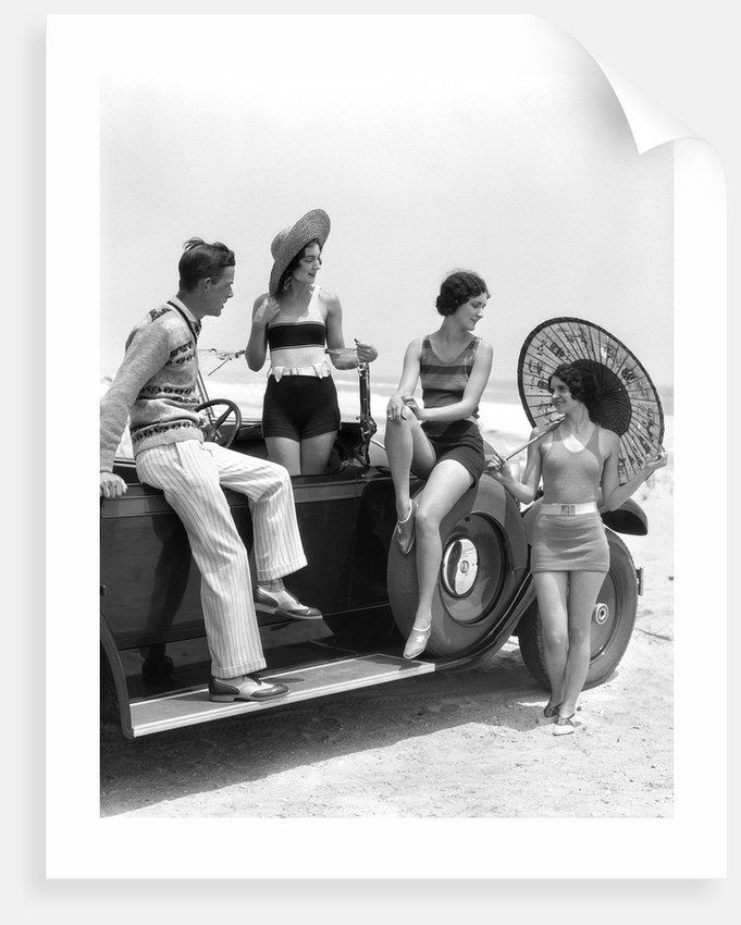 1920s 1930s Man And Three Women In Beach Clothes Or Bathing Suits Posing With Car On Running Board by Corbis