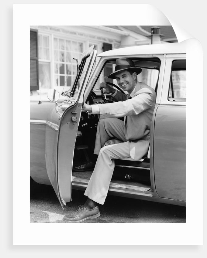 1950s Man Holding Car Door Open by Corbis
