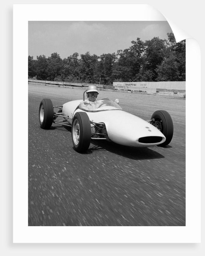 1960s Lotus Ford Race Car Speeding Around Track by Corbis