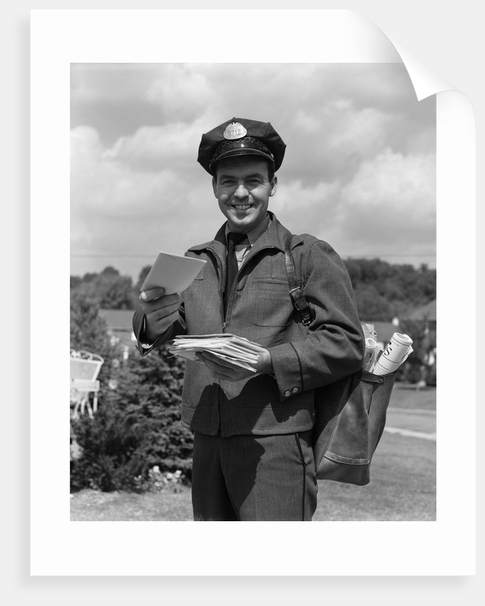 1950s Man Postman Holding Out Letter by Corbis