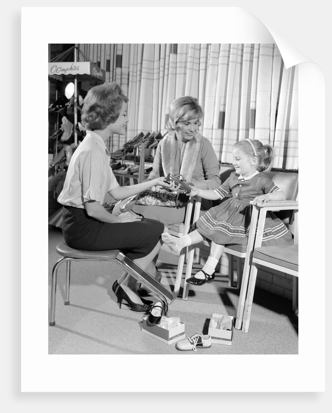 1960s Mother Daughter Shoe Shopping Saleswoman Showing Patent Leather Shoe To Girl by Corbis