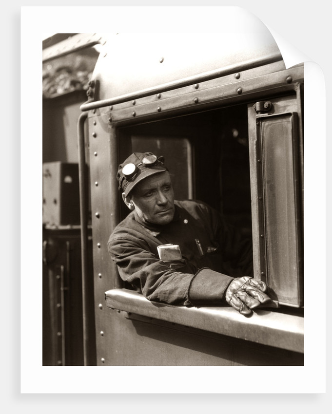 1920s 1930s 1940s Railroad Train Engineer Looking Out Window Of Locomotive Cab Driving The Steam Engine by Corbis