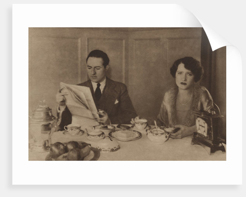 Husband and wife at breakfast by Corbis