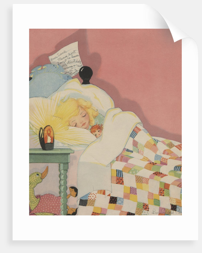Blond girl sleeping with note for Santa Claus by Corbis