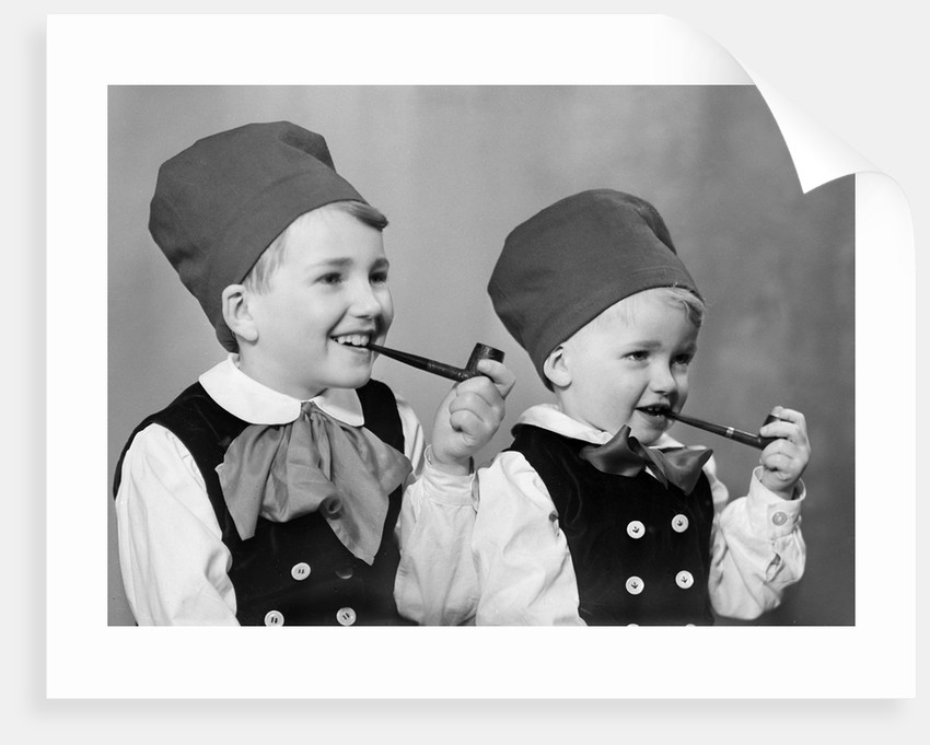 Two brothers in Bavarian costumes pretend to smoke pipes, ca. 1947 by Corbis
