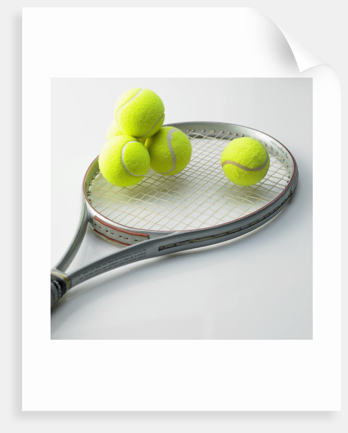 A tennis racket and balls by Corbis